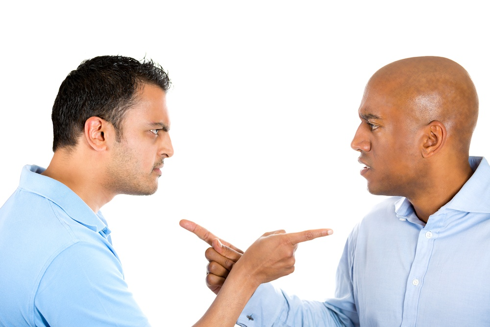 Closeup portrait of two angry guys pointing fingers at each other and blaming for problems, isolated on white background. Interpersonal conflict resolution. Human emotions and facial expressions..jpeg